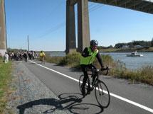 Biker biking the Michael Castle Trail along the Delaware Canal.