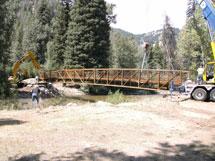 Construction crew and bridge.