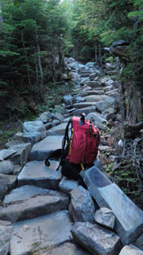 Hiking backpack on stone steps.