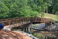 Pedestrian bridge over creek.