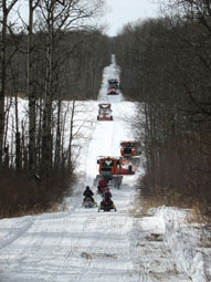 Snowmobiles along the Peace Garden Trail System.