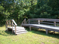 Equestrian mounting ramp alongside trail.