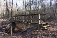 Wooden bridge over spring.